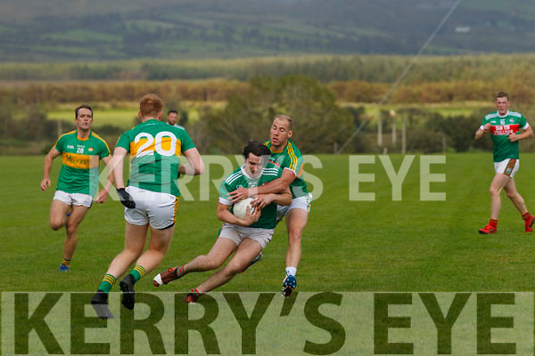 St Michael's Foilmore's Daragh Scanlon is tackled to the ground by Skellig Rangers Bernard Walsh.