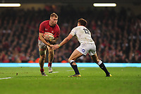Pictured: Ross Moriarty of Wales is tackled by Henry Slade of England during the Guinness six nations match between Wales and England at the Principality Stadium, Cardiff, Wales, UK.<br /> Saturday 23 February 2019
