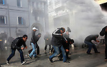 Protesters flee from the spray of a water canon during a demonstration against the interim government, in downtown Tunis, Tunisia, Jan. 17, 2011. The Tunisian police and army struggled to maintain order in the capital, as thousands of protesters once again filled the streets.