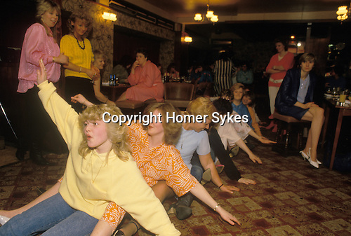 """South London. 1980's<br /> Rowing Boat Dance, danced to 'Oops Upside Your Head' otherwise known as """"I Don't Believe You Want To Get Up And Dance (Oops!)"""" by the Gap Band. Also known as the Row Boat song. This song was danced to by sitting on the floor and performing a rowing and wave movement. A Hen Night Duke of Cambridge, a South London pub."""