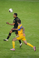 22nd December 2020, Orlando, Florida, USA;  LAFC Eddie Segura stops the ball during the Concacaf Championship between LAFC and Tigres UANL on December 22, 2020, at Exploria Stadium in Orlando, FL.