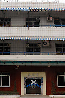 "Dingfu Factory in Houjie Town, Donguan, China.  The sign outside the factory that made shoes for Zara and Nine West amongst others, reads that the ""Donguan People's Court have closed the factory"" .  As the economy changes and Chinese labour gets more expensive, factories are cosing leaving ghost towns behind them.<br /> <br /> MUST CREDIT PHOTO BY RICHARD JONES/SINOPIX"