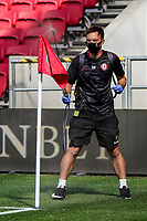 12th September 2020; Ashton Gate Stadium, Bristol, England; English Football League Championship Football, Bristol City versus Coventry City; Official sprays the corner flag before the game to protect from Covid
