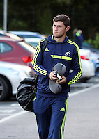 Wednesday 18 September 2013<br /> Pictured: Ben Davies about to board the team coach in Swansea. <br /> Re: Swansea City FC players and staff travelling to Spain for their UEFA Europa League game against Valencia.