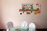 Inside a restaurant near the Zhalong Wetlands, Heilongjiang Province. China. 2011