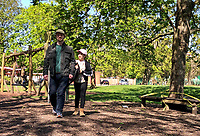 High Wycombe, England 20/04/2020 -<br /> People walk in the sun at RYE Park, High Wycombe during the COVID-19 pandemic lockdown as the UK Government advice to maintain social distancing and minimise time outside in High Wycombe on 20 April 2020. Photo by PRiME Media Images / Andy Rowland.