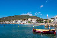 Spain, Costa Brava, Catalonia, Cadques.  boats in harbor.