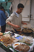 Fez, Morocco - Cooking Fish in the Market Place; Moroccan Fast Food.
