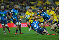 Jackson Garden-Bachop gets a pass away to Jordie Barrett during the Super Rugby Aotearoa match between the Hurricanes and Blues at Sky Stadium in Wellington, New Zealand on Saturday, 18 July 2020. Photo: Dave Lintott / lintottphoto.co.nz