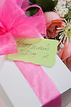 Gift with pink bow and flowers for Mother's day