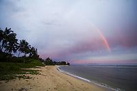 Double rainbow over a beach in Waialua at sunset