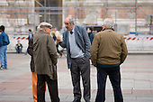 Elderly men talk in the Piazza Maggiore in the centre of Bologna