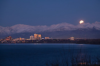 A full moon rises over Anchorage on Oct. 30, 2020.