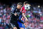 Raphael Varane of Real Madrid battles for an aerial ball Fernando Torres of Atletico de Madrid during the match of Champions League between Atletico de Madrid and Real Madrid at Vicente Calderon Stadium in Madrid, May 10, 2017. Spain.