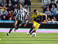 Pictured: Pablo Hernandez of Swansea (R) against Shola Ameobi (L) of Newcastle. Saturday 19 April 2014<br /> Re: Barclay's Premier League, Newcastle United v Swansea City FC at St James Park, Newcastle, UK.