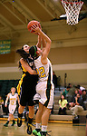 Manogue's Christa Young shoots against Galena defender Josie Peck at Manogue High School in Reno, Nev., on Tuesday, Feb. 11, 2014. Manogue won 51-29.<br /> Photo by Cathleen Allison