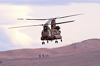 """Nevada Army National Guard Ch-47D """"Chinook"""" aircraft from Detachment 1, 140th Aviation Company flies over Lemon Valley, north of Reno, Nevada."""