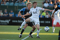 Jonathan Leathers (right) controls the ball ahead of Steven Lenhart (left). The San Jose Earthquakes tied the Vancouver Whitecaps 2-2 at Buck Shaw Stadium in Santa Clara, California on July 20th, 2011.