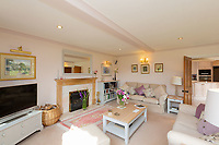 BNPS.co.uk (01202 558833)<br /> Pic: Savills/BNPS<br /> <br /> Pictured: The spacious living room.<br /> <br /> A historic thatched home where Cromwell's army stayed during the English Civil War is on the market for £1.6m.<br /> <br /> The Barracks, so-named for its links with Cromwell more than 370 years ago, has spectacular country views and is in one of Cheshire's most popular areas.<br /> <br /> The five-bedroom property just outside the picturesque village of Bunbury is a far cry from how it would have looked in Cromwell's time, having been extended over the years.<br /> <br /> It was used in the 17th century by Cromwell's armies during the siege of Beeston Castle - two miles away. The castle's location made it valuable to both the royalists and parliamentarians.