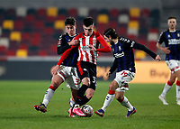 9th January 2021; Brentford Community Stadium, London, England; English FA Cup Football, Brentford FC versus Middlesbrough; Alex Gilbert of Brentford is challenged by Hayden Hackney and Patrick Roberts of Middlesbrough