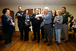 Members of Carson City Elks Lodge No. 2177 presents a check to Holiday with a Hero representatives during a short ceremony, in Carson City, Nev., on Tuesday, Nov. 27, 2018. The program, in its 15th year, provides a Christmas shopping spree to 300 local homeless children each year. The students, part of the Carson City School District McKinney-Vento program, are paired with first responders and other community volunteers. <br /> Photo by Cathleen Allison/Nevada Momentum