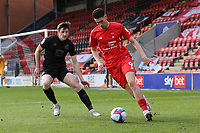 Conor Wilkinson of Leyton Orient and Adam Crookes of Port Vale during Leyton Orient vs Port Vale, Sky Bet EFL League 2 Football at The Breyer Group Stadium on 20th February 2021