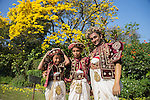10 March 2015, Kandy, Sri Lanka:  Members of a Sri Lankan wedding party preparing for festivities at the Botanic Gardens in Kandy, Central Province, Sri Lanka. Kandy is the second largest city in the country after Colombo. It was the last capital of the ancient kings' era of Sri Lanka. The city lies in the midst of hills in the Kandy plateau, which crosses an area of tropical plantations, mainly tea. Kandy is both an administrative and religious city and is also the capital of the Central Province. Kandy is the home of The Temple of the Tooth Relic (Sri Dalada Maligawa), one of the most sacred places of worship in the Buddhist world. It was declared a world heritage site by UNESCO in  1988. Picture by Graham Crouch for the New York Times
