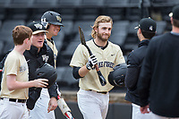 Johnny Aiello (2) of the Wake Forest Demon Deacons is handed the lucky shovel by teammate Drew Loepprich (black jacket) after hitting a home run against the Georgia Tech Yellow Jackets at David F. Couch Ballpark on March 26, 2017 in  Winston-Salem, North Carolina.  The Demon Deacons defeated the Yellow Jackets 8-4.  (Brian Westerholt/Four Seam Images)