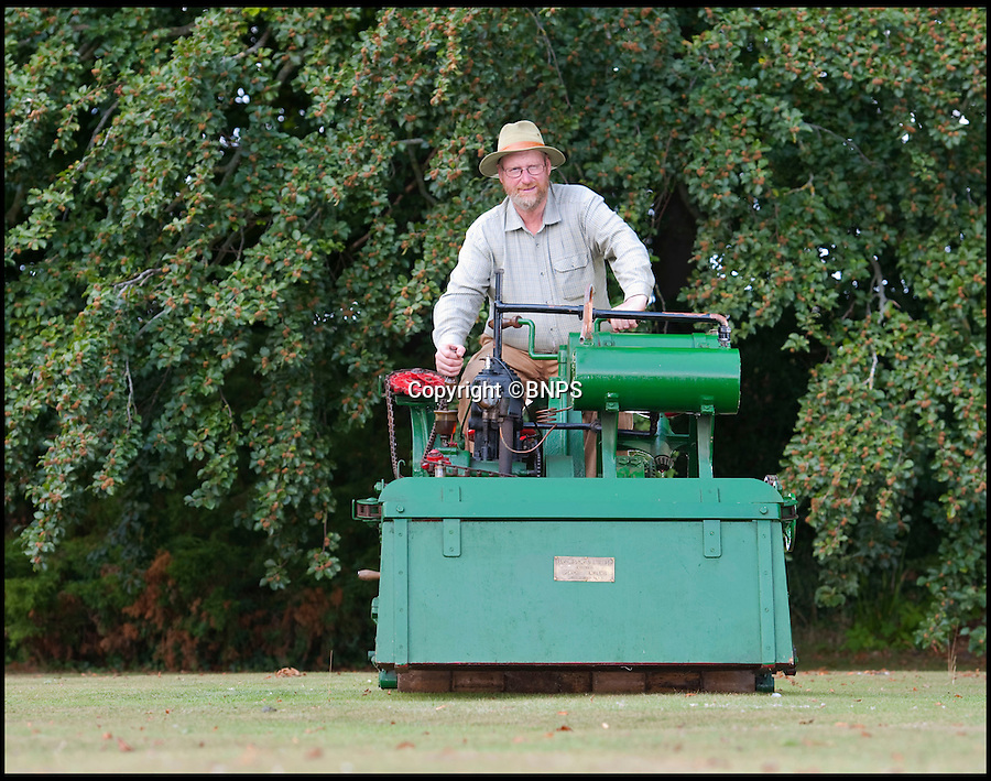 BNPS.co.uk (01202 558833)<br /> Pic: PhilYeomans/BNPS.co.uk<br /> <br /> Lawnmowing history...<br /> <br /> The worlds first powered mower has taken to the grass once more after an exhaustive restoration by lawnmower nut Andrew Hall from Somerset.<br /> <br /> Forerunner of all the machines that have graced British lawns on sunday afternoons through the decades since, This 1902 Ransome 3hp is a historic survivor from the Edwardian age when chauffers were given the task of grooming their masters lawns and the new fangled machines cost as much as a house.<br /> <br /> The 1 1/4 ton leviathan cost £137 in 1903 - equivalent to a whopping £15,000 in todays money. In consequence they were only available to the very rich, but aristocratic one upmanship lead to a rapid 'lawnmower arms race' untill the first war intervened.