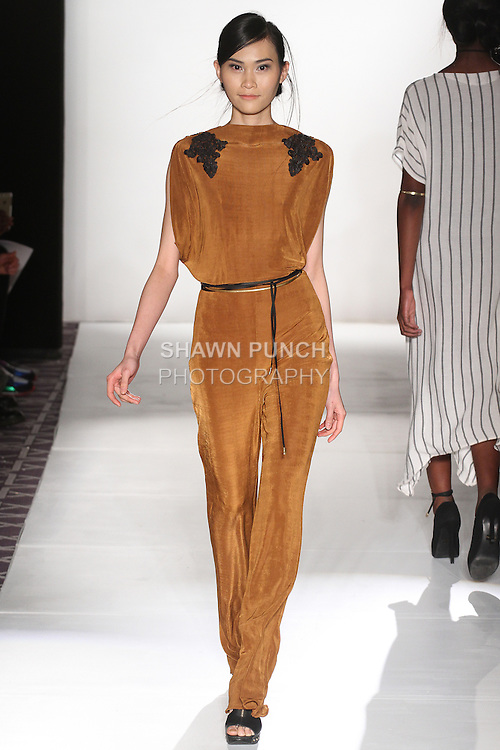 "Model walks runway in an outfit from the Adriana Carolina Fall Winter 2015-2016 ""Floresta"" collection, during the Emerging Designers Fall Winter 2015 fashion show for  Fashion Gallery New York Fashion Week Fall 2015."