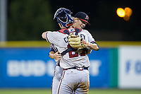 Danville Braves relief pitcher Landon Hughes (23) gets a hug from catcher Alan Crowley (27) after closing out the game against the Burlington Royals at Burlington Athletic Stadium on August 12, 2017 in Burlington, North Carolina.  The Braves defeated the Royals 5-3.  (Brian Westerholt/Four Seam Images)