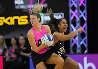 Kate Heffernan beats Ainsleyana Puleiata to the ball during the Cadbury Netball Series match between NZ A and NZ Under-21 at the Fly Palmy Arena in Palmerston North, New Zealand on Saturday, 24 October 2020. Photo: Dave Lintott / lintottphoto.co.nz