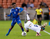 HOUSTON, TX - JANUARY 28: Melchie Dumonay #6 of Haiti fouls Julie Ertz #8 of the United States during a game between Haiti and USWNT at BBVA Stadium on January 28, 2020 in Houston, Texas.