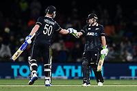 23rd March 2021; Christchurch, New Zealand;  James Neesham of the Black Caps congratulates Tom Latham of the Black Caps on reaching 50 runs during the 2nd ODI cricket match, Black Caps versus Bangladesh, Hagley Oval, Christchurch, New Zealand.