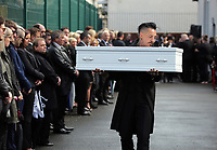 """COPY BY TOM BEDFORD<br /> Pictured: Paul Black carries the white coffin of his daughter Pearl after the service out of the Jerusalem Baptist Chapel in Merthyr Tydfil, Wales, UK. Friday 18 August 2017<br /> Re: The funeral of a toddler who died after a parked Range Rover's brakes failed and it hit a garden wall which fell on top of her will be held today at Jerusalem Baptist Chapel in Merthyr Tydfil.<br /> One year old Pearl Melody Black and her eight-month-old brother were taken to hospital after the incident in south Wales.<br /> Pearl's family, father Paul who is The Voice contestant and mum Gemma have said she was """"as bright as the stars""""."""