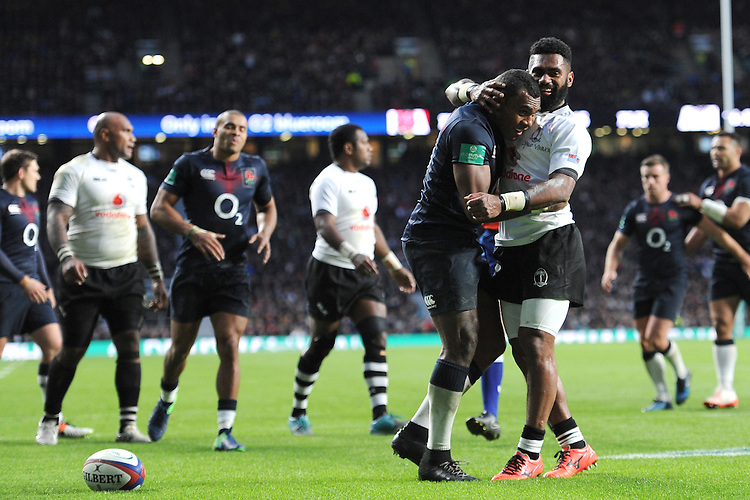 Semesa Rokoduguni of England is congratulated by countryman Seru Vularika of Fiji after his second try of the afternoon during the Old Mutual Wealth Series match between England and Fiji at Twickenham Stadium on Saturday 19th November 2016 (Photo by Rob Munro)