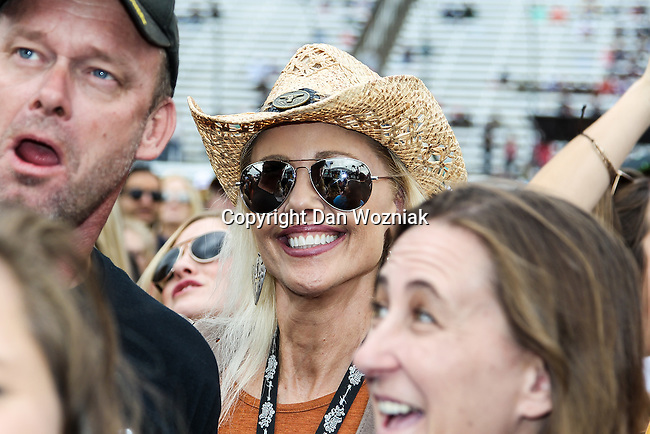 Fans and drivers in action before the NASCAR AAA Texas 500 race at Texas Motor Speedway in Fort Worth,Texas.