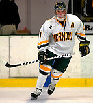 """5 January 2007: University of Vermont forward Chris Myers (21) from South Boston, MA, in action against the University of New Hampshire Wildcats at Gutterson Fieldhouse in Burlington, Vermont. The UNH Wildcats defeated the UVM Catamounts 7-1 in front of a record setting 48th consecutive sellout at """"the Gut""""...Mandatory Photo Credit: Ed Wolfstein Photo.<br />"""