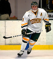 "5 January 2007: University of Vermont forward Chris Myers (21) from South Boston, MA, in action against the University of New Hampshire Wildcats at Gutterson Fieldhouse in Burlington, Vermont. The UNH Wildcats defeated the UVM Catamounts 7-1 in front of a record setting 48th consecutive sellout at ""the Gut""...Mandatory Photo Credit: Ed Wolfstein Photo.<br />"