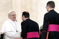 Papa Francesco saluta alcuni prelati al termine dell'udienza generale del mercoledi' in Piazza San Pietro, Citta' del Vaticano, 27 marzo 2013..Pope Francis greets prelates at the end of his weekly general audience in St. Peter's square at the Vatican, 27 March 2013..UPDATE IMAGES PRESS/Riccardo De Luca..STRICTLY ONLY FOR EDITORIAL USE