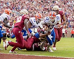 Florida Gators quarterback Feleipe Franks (13) is brought down just short of the goal line by Florida State defensive back Jaiden Woodbey (20) in the 1st half of an NCAA college football game in Tallahassee, Fla., Saturday, Nov. 24, 2018. (AP Photo/Mark Wallheiser)