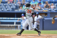 Augusta GreenJackets left fielder Jean Angomas (29) swings at a pitch during a game against the Asheville Tourists at McCormick Field on July 16, 2017 in Asheville, North Carolina. The GreenJackets defeated the Tourists 10-9. (Tony Farlow/Four Seam Images)