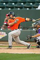 Allan de San Miguel (11) of the Frederick Keys follows through on his swing against the Winston-Salem Dash at BB&T Ballpark on May 28, 2013 in Winston-Salem, North Carolina.  The Dash defeated the Keys 17-5 in the first game of a double-header.  (Brian Westerholt/Four Seam Images)