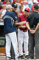 Arkansas Razorbacks head coach Dave Van Horn exchanges lineup cards with Virginia Cavaliers head coach Brian O'Connor before Game 1 of the NCAA College World Series on June 13, 2015 at TD Ameritrade Park in Omaha, Nebraska. Virginia defeated Arkansas 5-3. (Andrew Woolley/Four Seam Images)