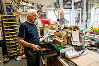 BNPS.co.uk (01202 558833)<br /> Pic: MaxWillcock/BNPS<br /> <br /> Pictured: Ray serving customers using his original 1960s shop till that still works.<br /> <br /> Tireless Ray Fisher still works full-time in the motorcycle shop he opened 62 years ago - and he has plenty left in the tank.<br /> <br /> The 85 year old founded Ray Fisher's Brickbits in Christchurch, Dorset, in 1959 after training as a bike mechanic.<br /> <br /> It is a family affair as his two children Gerry, 58, and Stephanie, 54, have both worked solely for him since leaving school aged 16.<br /> <br /> Ray said he had loved bikes since childhood and learnt how to repair them while doing national service in the early 1950s.