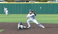 Bentonville West's Ty Durham beats the throw to Rogers' second baseman Noah Goodshield Monday April 5, 2021. Rogers won 6-1. Visit nwaonline.com/210405Daily/ and nwadg.com/photos. (NWA Democrat-Gazette/J.T. Wampler)