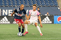 FOXBOROUGH, MA - SEPTEMBER 04: Wojciech Wojcik #9 Forward Madison FC comes in to tackle Tiago Mendonca #33 of New England Revolution II during a game between Forward Madison FC and New England Revolution II at Gillette Stadium on September 04, 2020 in Foxborough, Massachusetts.