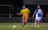 Danny Rowe of Wycombe Wanderers plays a pass under pressure from Matty Taylor of Bristol Rovers during the Johnstone's Paint Trophy match between Bristol Rovers and Wycombe Wanderers at the Memorial Stadium, Bristol, England on 6 October 2015. Photo by Andy Rowland.