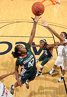 Jan. 6, 2011; Charlottesville, VA, USA; Miami Hurricanes guard Shenise Johnson (42) reaches for the rebound during the game against the Virginia Cavaliers at the John Paul Jones Arena. Miami won 82-73. Mandatory Credit: Andrew Shurtleff-