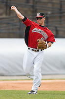 Third baseman Matt West #11 of the Hickory Crawdads makes a throw to first base at L.P. Frans Stadium June 21, 2009 in Hickory, North Carolina. (Photo by Brian Westerholt / Four Seam Images)